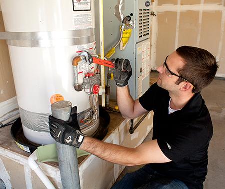 plumber handles water heater repair in Concord, California by tightening intake line
